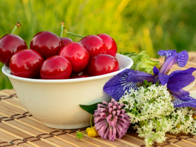 bowl of cherries with flowers