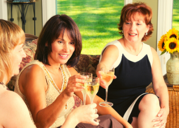 women toasting with sparkling beverages