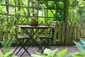 table for two in lush garden setting
