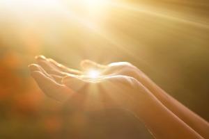 hands receiving divine light